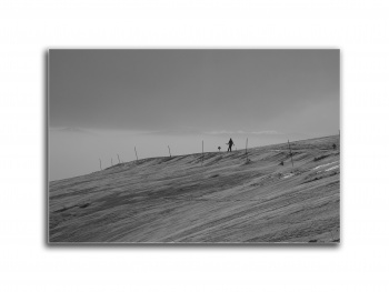 the silhouette of a lonely skier in the Old Mountain