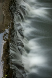 a small waterfall frozen by longexposure